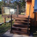 AFTER PICTURE OF THE NEW COMPOSITE DECK WITH REGAL ALUMINUM RAILING SYSTEM
