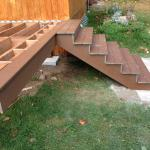 AFTER PICTURE OF THE NEW COMPOSITE DECK AND NEW STAIRS WITH COMPOSITE STEPS